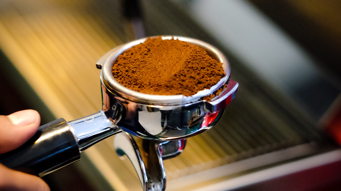 Ground coffee beans in a coffee machine